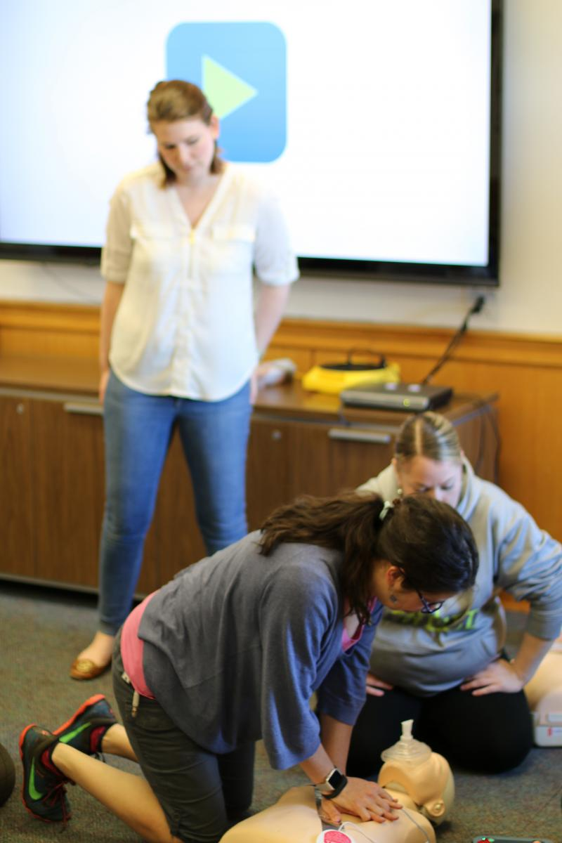 Ruth Elizabeth Miller practices CPR under the watchful eye of Kelly Predmore during a recent CPR/AED training class for Lehigh staff and faculty.